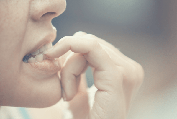 woman biting her nails, anxiety, nervous, stress