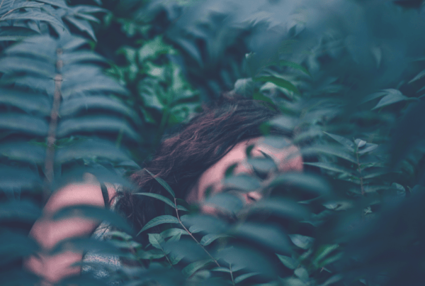 Lucid Dreaming woman sleeping in jungle leaves