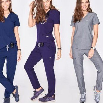 Women in stylish scrubs by FIGS